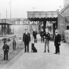 Whittlesford Railway Station with people and horses on the track.