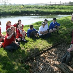Children with the Little Ouse behind them, the river where the prisoners were hanged